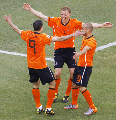 Netherlands' Dirk Kuyt, Wesley Sneijder and Robin van Persie celebrate against Denmark