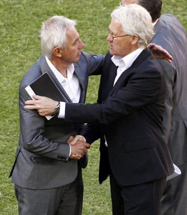 Denmark's coach Morten Olsen shakes hands with the Netherlands' coach Bert van Marwijk during a 2010 World Cup