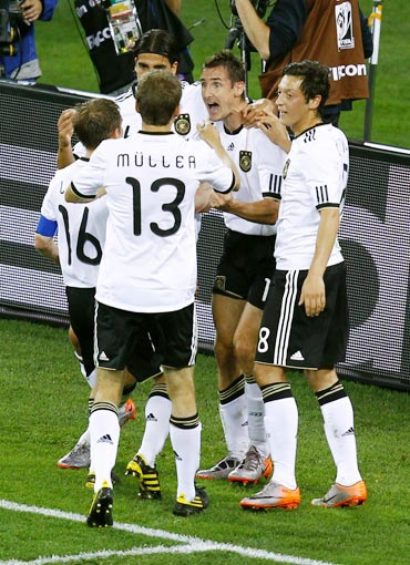 German players celebrate after scoring a goal