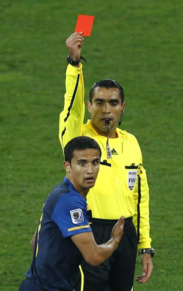 Australia's Tim Cahill reacts after getting a red card