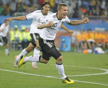 Lukas Podolski celebrates after scoring