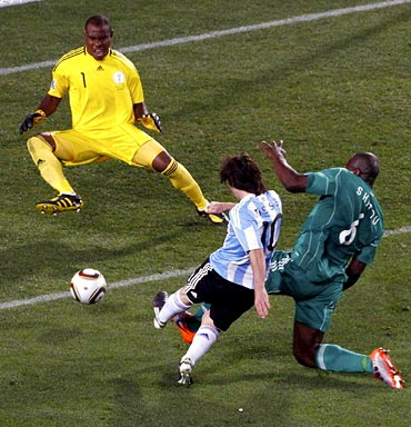 Messi's shot is saved by Nigeria goalkeeper Vincent Enyeama