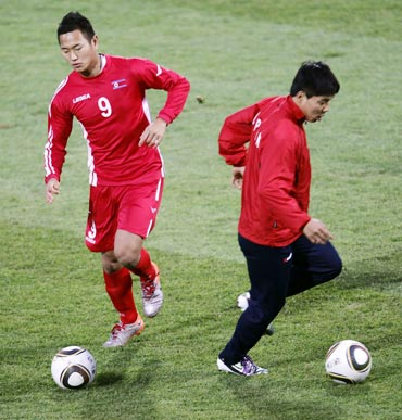 North Korean players during a warm up session