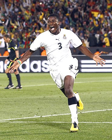 Ghana's Asamoah Gyan celebrates after conveting a penalty against Serbia