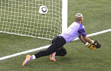 Algeria's goalkeeper Faouzi Chaouchi concedes a goal against Slovenia