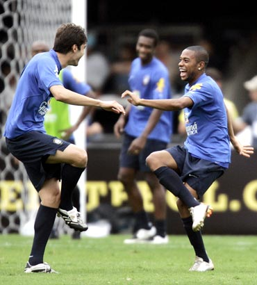 Robinho (right) dances with Kaka