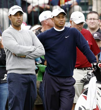 Arjun Atwal with Tiger Woods