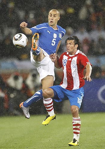 Italy's Fabio Cannavaro and Paraguay's Nelson Haedo Valdez (right) vie for possession