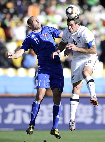 New Zealand's Ryan Nelsen (right) and Slovakia's Robert Vittek are involved in an aeriel duel