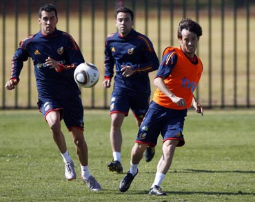 Spain's Sergio Busquets, Xavi and David Silva during a training session