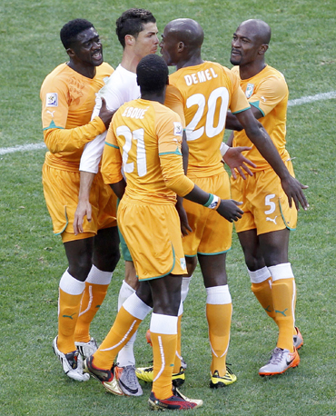Portugal's Cristiano Ronaldo argues with Ivory Coast's Guy Demel while teammate Emmanuel Eboue watches