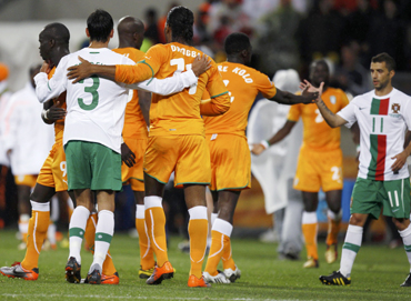 Portugal and Ivory Coast players greet each other at the end of a 2010 World Cup Group G soccer match in Port Elizabeth