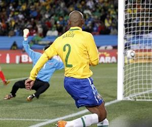 Maicon (2) sends the ball past North Korea's goalkeeper Ri Myong-guk