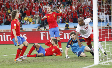 Spain players react after Switzerland's Fernandes scored during the 2010 World Cup Group H match