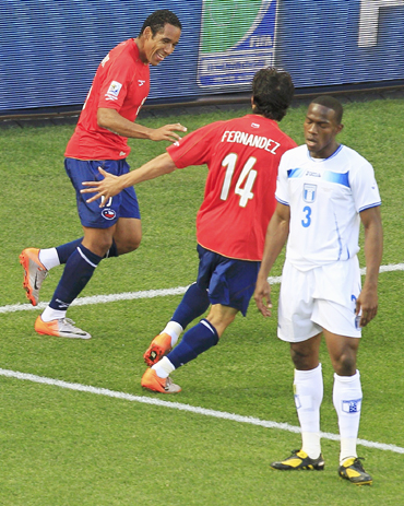 Chile's Jean Beausejour celebrates his goal with team mate Matias Fernandez during their 2010 World Cup Group H match against Honduras