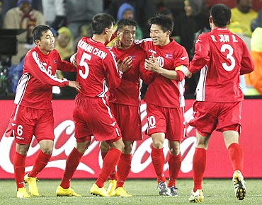 North Korea's Ji Yun-nam (centre) celebrates with team-mates after scoring against Brazil