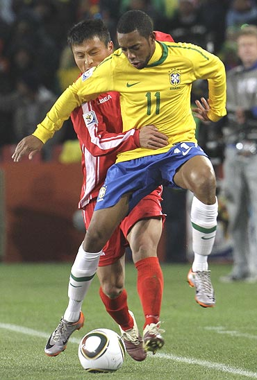 Brazil's Robinho (front) and North Korea's Pak Nam-chol vie for possession