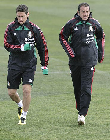 Mexican striker Cuauhtemoc Blanco (right) and team-mate Guillermo Franco go through the grind at a training camp