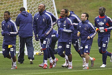 French players warm up during a training session