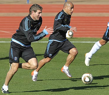 Argentina's Martin Palermo (left) and Clemente Rodriguez go through the grind at a training session