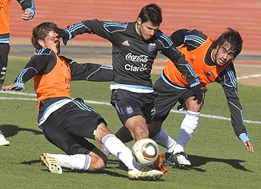 Argentina's Sergio Aguero (centre) battles for the ball with team-mates during a practice match