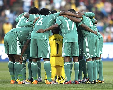 Nigerian players form a huddle before the match against Argentina played last week