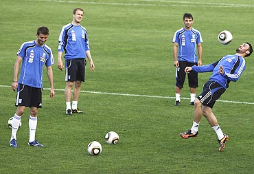 Greek players go through the paces during a training session