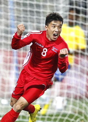 North Korea's Ji Yun-nam celebrates after scoring against Brazil