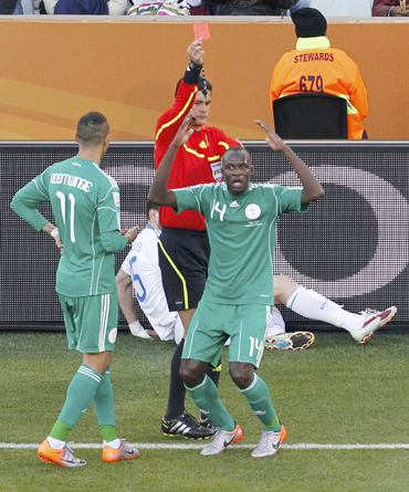 Nigeria's Sani Kaita (R) reacts after referee Oscar Ruiz of Colombia shows him a red card