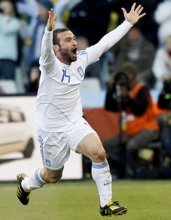 Dimitris Salpigidis celebrates after scoring Greece's first ever World Cup goal