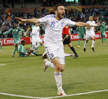 Greece's Vassilis Torosidis celebrates his goal during the 2010 World Cup Group B soccer match against Nigeria