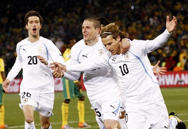 Diego Forlan (right) celebrates with team-mates after scoring