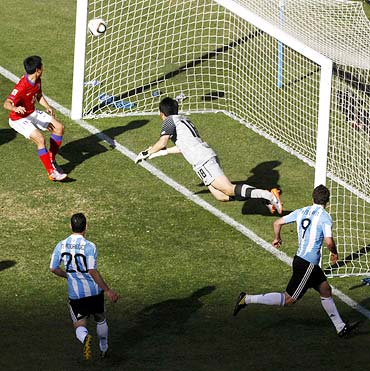 Gonzalo Higuain heads in the ball to complete his hat-trick