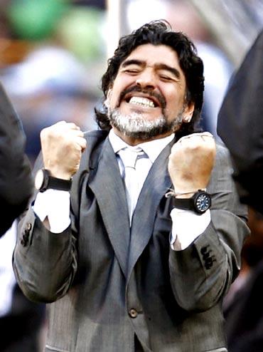 Argentina's coach Diego Maradona celebrates