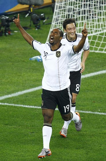 Cacau celebrates after scoring against Australia