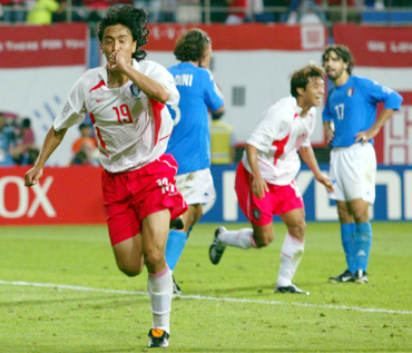 South Korea's Ahn Jung-hwan (left) celebrates his golden goal with teammate Hwang Sun-hong (second right) as Italy's Paolo Maldini (second left) and Damiano Tommasi stand in disbelief