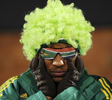 A South African fan reacts after his team's loss to Uruguay