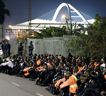 Security personnel are held by police in Durban