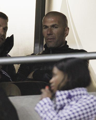 Zinedine Zidane watches the match
