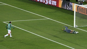 Mexico's Cuauhtemoc Blanco scores a penalty against France