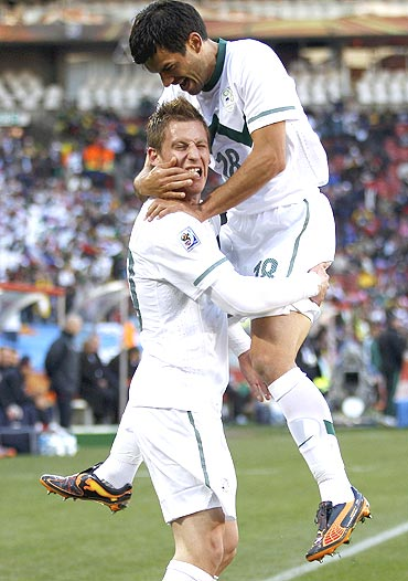 Slovenia's Valter Birsa (left) celebrates with teammate Aleksander Radosavljevic after scoring