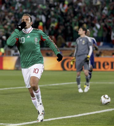 Mexico's Cuauhtemoc Blanco celebrates after scoring a penalty against France
