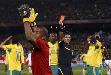 South African goalkeeper reacts after getting a red card