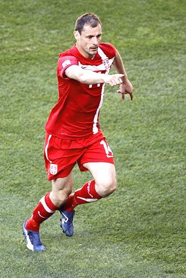 Serbia's Milan Jovanovic celebrates after scoring against Germany