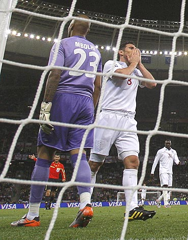 England's Frank Lampard (right) reacts after missing a scoring opportunity