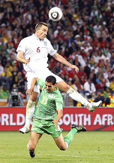 Algeria's Karim Matmour and England's John Terry (left) vie for possession