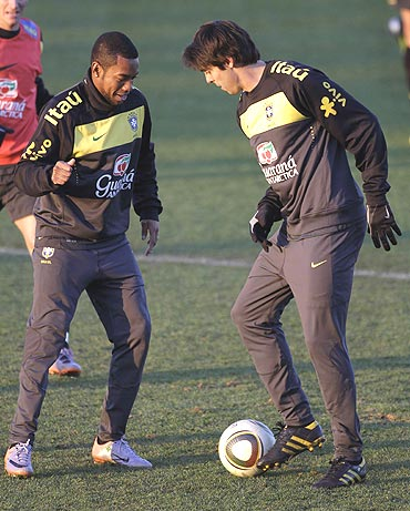 Brazil's Robinho (left) and Kaka at a training session