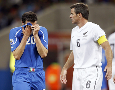 Italy's Giampaolo Pazzini reacts near New Zealand's Ryan Nelsen