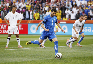 Italy's Vincenzo Iaquinta takes the penalty kick against New Zealand