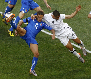 Italy's Gilardino fights for the ball with New Zealand's Reid during their 2010 World Cup Group F soccer match